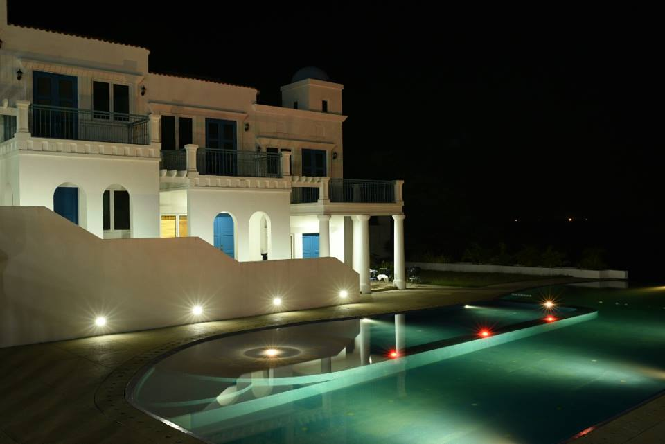 camp netanya infinity pool at night