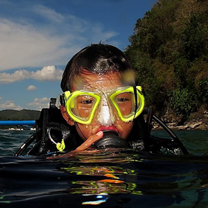 a square photo of kid scuba diving